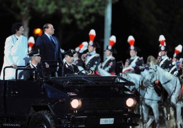 Berlusconi Gadafi AFP